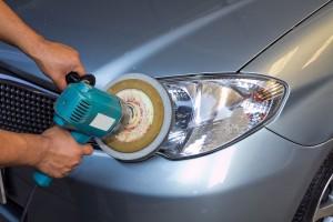 image of technician restoring headlight on customer vehicle